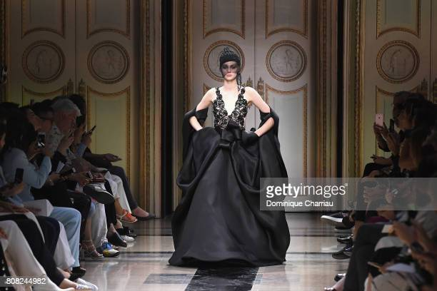 A model walks the runway during the Giorgio Armani Prive Haute Couture Fall/Winter 20172018 show as part of Haute Couture Paris Fashion Week on July...