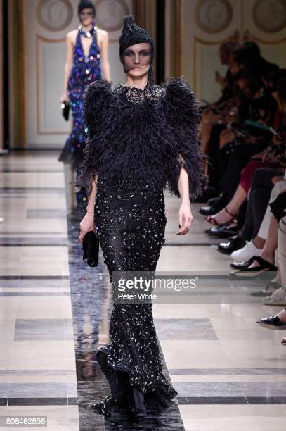 Model walks the runway during the Giorgio Armani Prive Haute Couture Fall/Winter 2017-2018 show as part of Haute Couture Paris Fashion Week on July...