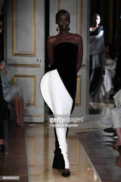 A model walks the runway during the Giorgio Armani Prive Haute Couture Fall Winter 2018/2019 show as part of Paris Fashion Week on July 3 2018 in...