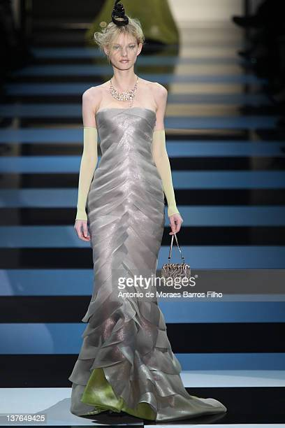 A model walks the runway during the Giorgio Armani Prive HauteCouture 2012 show as part of Paris Fashion Week at Grand Palais on January 24 2012 in...