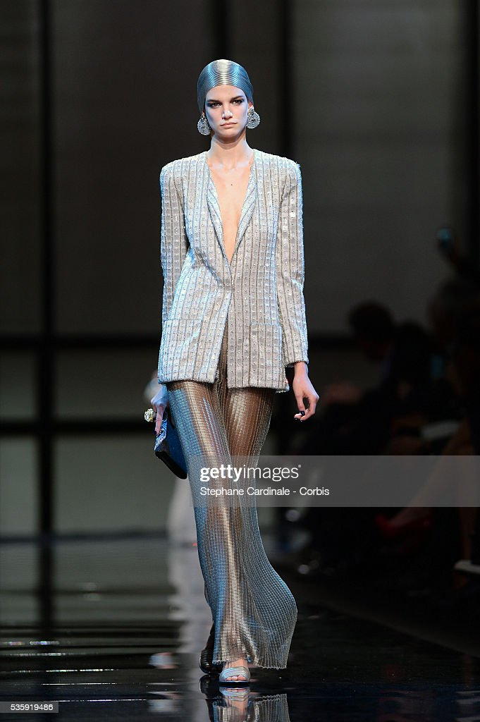 A model walks the runway during the Giorgio Armani Prive show as part of Paris Fashion Week Haute Couture Spring/Summer 2014, at Palais de tokyo in Paris.