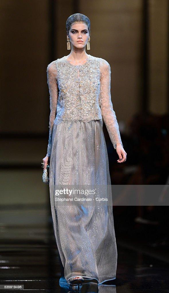 A model walks the runway during the Giorgio Armani Prive show as part of Paris Fashion Week Haute Couture Spring/Summer 2014, at Palais de tokyo in Paris.