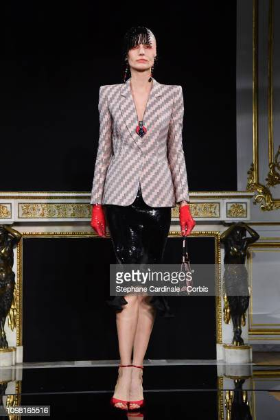 A model walks the runway during the Giorgio Armani Prive Spring Summer 2019 show as part of Paris Fashion Week on January 22 2019 in Paris France