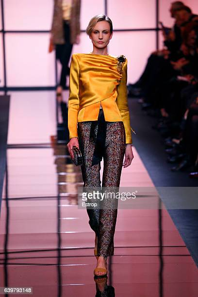 A model walks the runway during the Giorgio Armani Prive Spring Summer 2017 show as part of Paris Fashion Week on January 24 2017 in Paris France