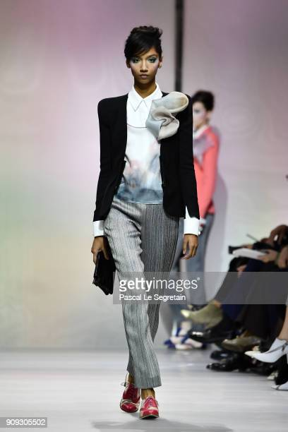 A model walks the runway during the Giorgio Armani Prive Spring Summer 2018 show as part of Paris Fashion Week on January 23 2018 in Paris France