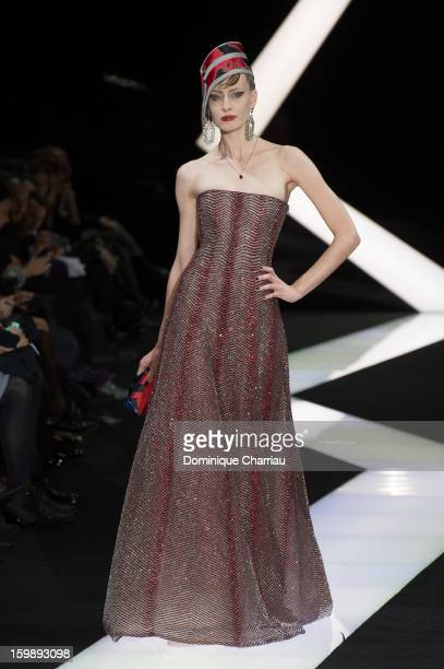 Model walks the runway during the Giorgio Armani Prive Spring/Summer 2013 Haute-Couture show as part of Paris Fashion Week at Theatre National de...