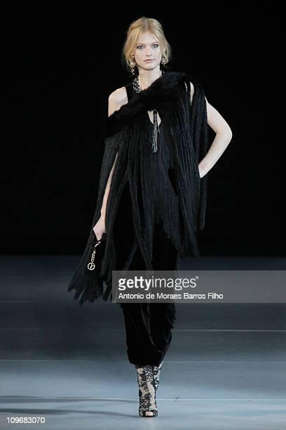 Model walks the runway during the Giorgio Armani show as part of Milan Fashion Week Womenswear Autumn/Winter 2011 on February 28, 2011 in Milan,...