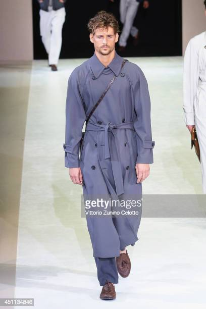 A model walks the runway during the Giorgio Armani show as part of Milan Fashion Week Menswear Spring/Summer 2015 on June 24 2014 in Milan Italy