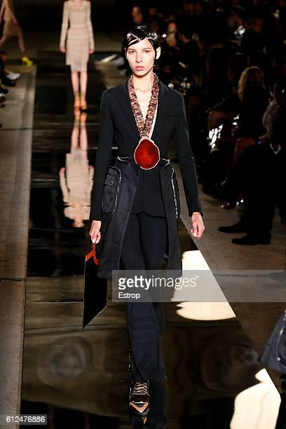 A model walks the runway during the Givenchy designed by Riccardo Tisci show as part of the Paris Fashion Week Womenswear Spring/Summer 2017 on...