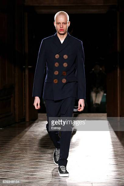 A model walks the runway during the Givenchy designed by Riccardo Tisci Menswear Fall/Winter 20172018 show as part of Paris Fashion Week on January...