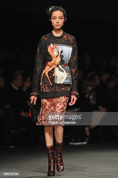 A model walks the runway during the Givenchy Fall/Winter 2013 ReadytoWear show as part of Paris Fashion Week on March 3 2013 in Paris France