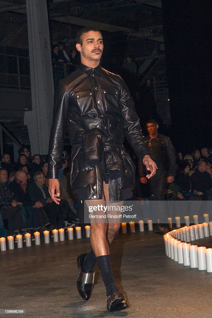 A model walks the runway during the Givenchy Men Autumn / Winter 2013 show as part of Paris Fashion Week on January 18, 2013 in Paris, France.