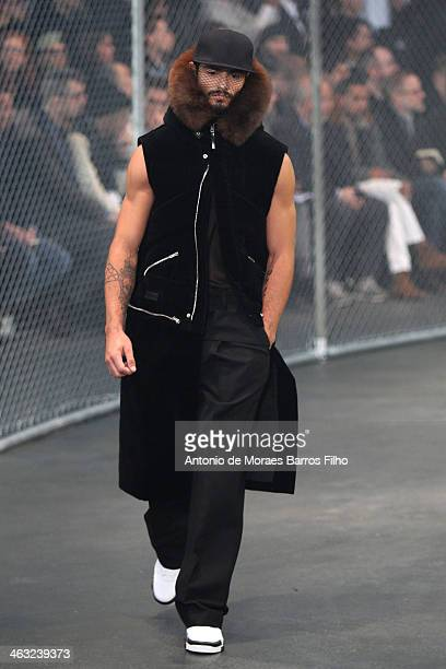 A model walks the runway during the Givenchy Menswear Fall/Winter 20142015 show as part of Paris Fashion Week on January 17 2014 in Paris France