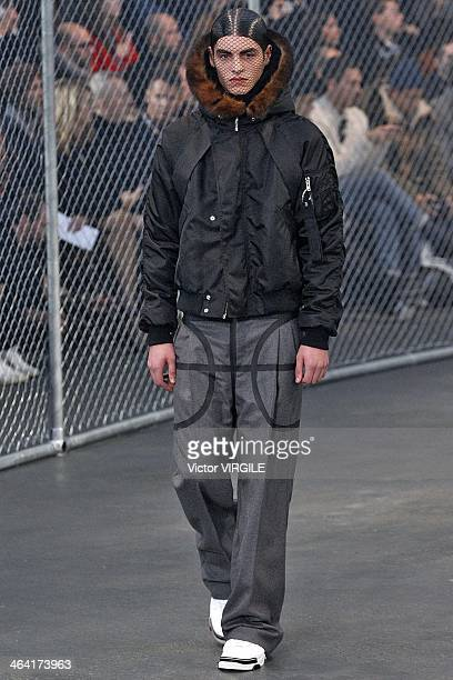 A model walks the runway during the Givenchy Menswear Ready to Wear Fall/Winter 20142015 show as part of Paris Fashion Week on January 17 2014 in...