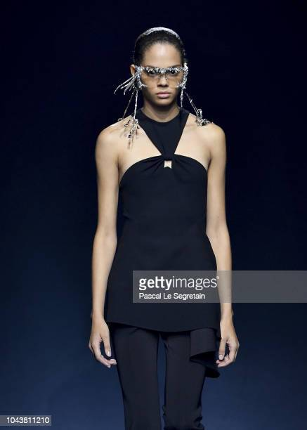 A model walks the runway during the Givenchy show as part of the Paris Fashion Week Womenswear Spring/Summer 2019 on September 30 2018 in Paris France