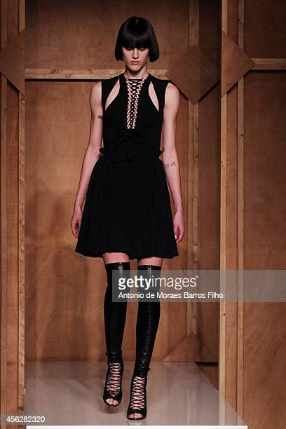 A model walks the runway during the Givenchy show as part of the Paris Fashion Week Womenswear Spring/Summer 2015 on September 28 2014 in Paris France