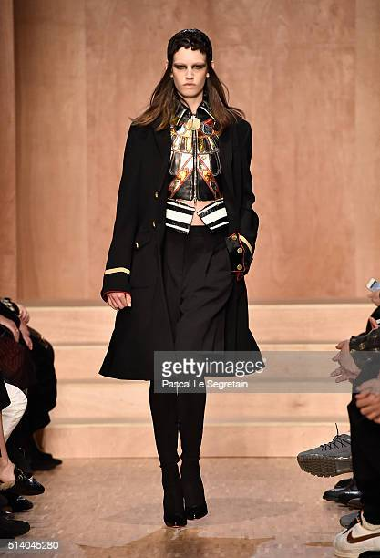 A model walks the runway during the Givenchy show as part of the Paris Fashion Week Womenswear Fall/Winter 2016/2017 on March 6 2016 in Paris France