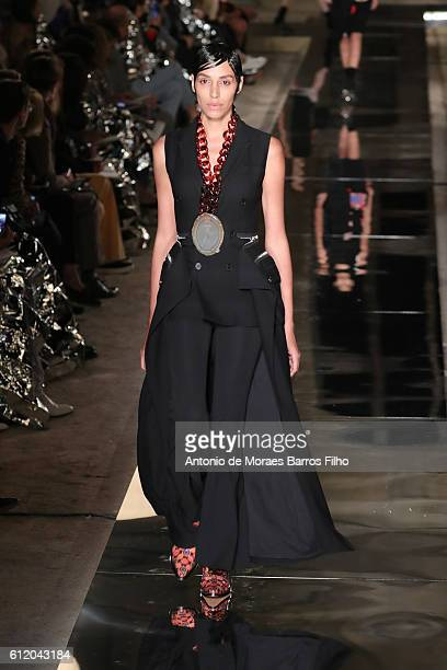A model walks the runway during the Givenchy show as part of the Paris Fashion Week Womenswear Spring/Summer 2017 on October 2 2016 in Paris France
