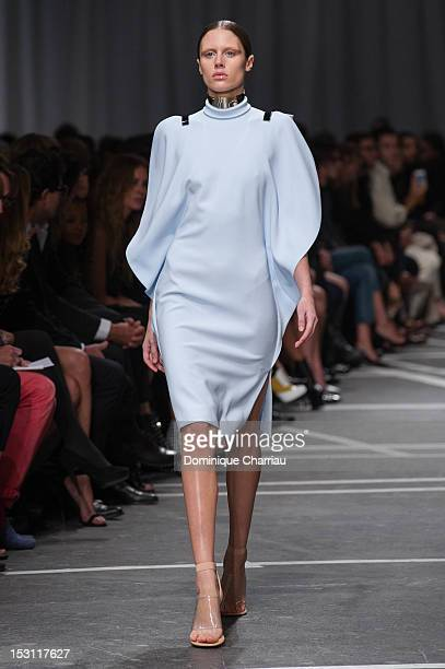 A model walks the runway during the Givenchy Spring / Summer 2013 show as part of Paris Fashion Week on September 30 2012 in Paris France
