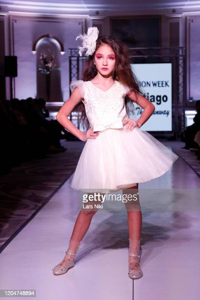 A model walks the runway during the Glorie Santiago show at the Cosmopolitan NYFW FW20 fashion show during New York Fashion Week at Lotte New York...