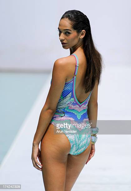 Model walks the runway during the Gottex fashion show at Mercedes-Benz Fashion Week Swim 2014 - Runway at SLS Hotel on July 21, 2013 in Miami,...