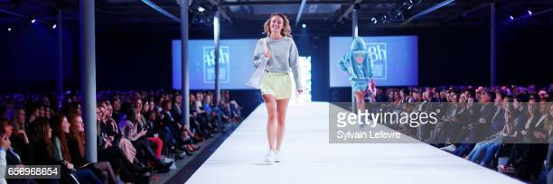 A model walks the runway during the green shots fashion designers of Maisons de Mode show as part of the Lille Fashion Day 2nd edition on March 21...