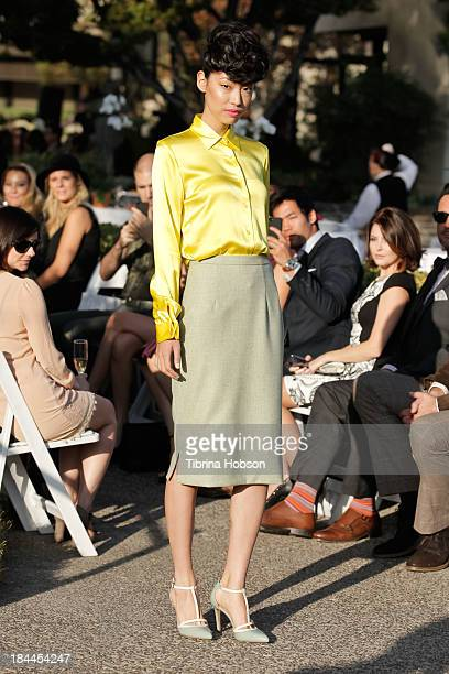 A model walks the runway during the Greg Lavoi spring 2014 runway presentation at Kyoto Gardens on October 13 2013 in Los Angeles California