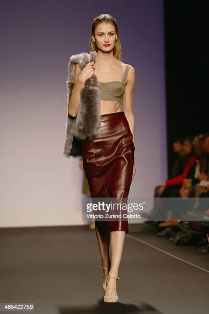 A model walks the runway during the Greta Boldini fashion show at Altaroma Altamoda on January 27 2014 in Rome Italy
