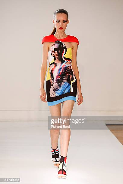 A model walks the runway during the Ground Zero show as part of the Paris Fashion Week Womenswear Spring/Summer 2014 on September 24 2013 in Paris...