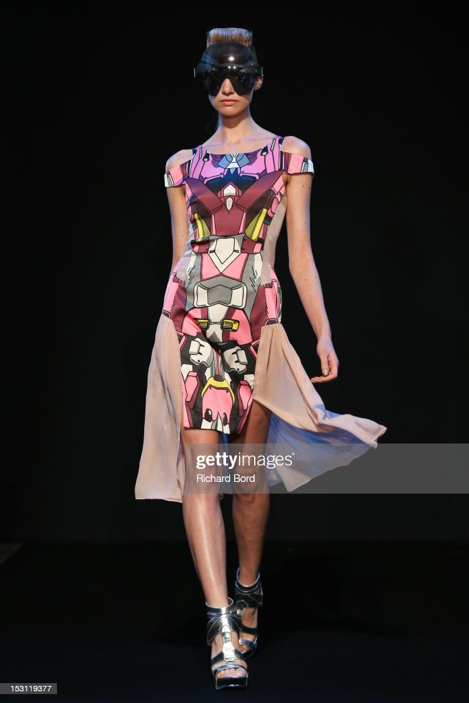 A model walks the runway during the Ground Zero Spring/Summer 2013 show as part of Paris Fashion Week at Pavillon Wagram on September 30, 2012 in Paris, France.