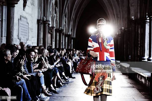 Model walks the runway during the Gucci Cruise 2017 fashion show at the Cloisters of Westminster Abbey on June 2, 2016 in London, England.