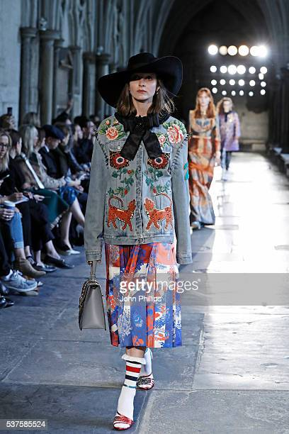 A model walks the runway during the Gucci Cruise 2017 fashion show at the Cloisters of Westminster Abbey on June 2 2016 in London England