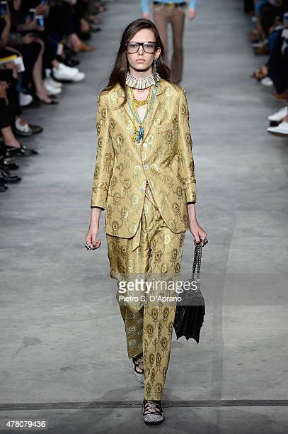 A model walks the runway during the GUCCI fashion show as part of Milan Men's Fashion Week Spring/Summer 2016 on June 22 2015 in Milan Italy