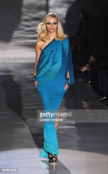 A model walks the runway during the Gucci fashion show at Milan Fashion Week Spring/Summer 2009 on September 24 2008 in Milan Italy