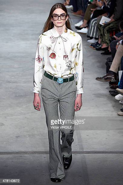 A model walks the runway during the GUCCI Ready to Wear fashion show as part of Milan Men's Fashion Week Spring/Summer 2016 on June 22 2015 in Milan...