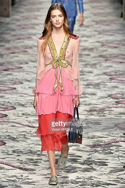 8407d72eaf6 A model walks the runway during the Gucci Ready to Wear fashion show as  part of