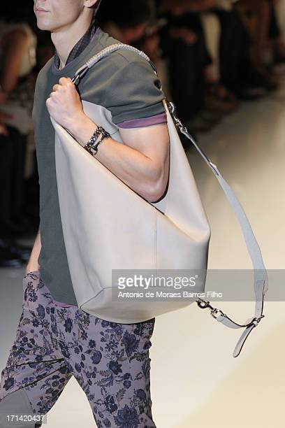 Model walks the runway during the Gucci show as a part of MFW S/S 2014 on June 24, 2013 in Milan, Italy.