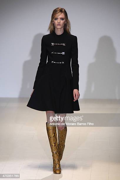 Model walks the runway during the Gucci show as a part of Milan Fashion Week Womenswear Autumn/Winter 2014 on February 19, 2014 in Milan, Italy.