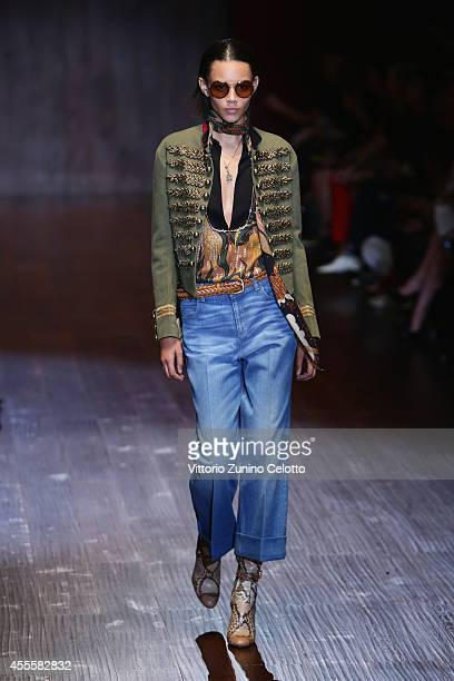 A model walks the runway during the Gucci show as part of Milan Fashion Week Womenswear Spring/Summer 2015 on September 17 2014 in Milan Italy