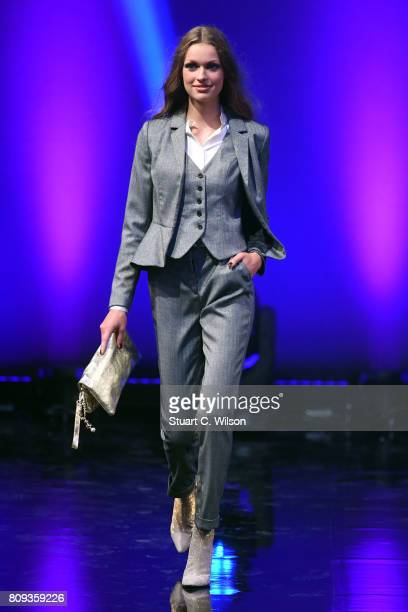 A model walks the runway during the Guido Maria Kretschmer Fashion Show Autumn/Winter 2017 at Tempodrom on July 5 2017 in Berlin Germany