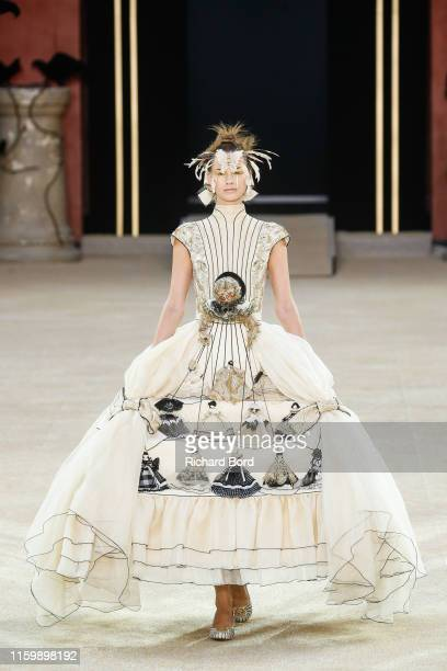 Model walks the runway during the Guo Pei Fall/Winter 2019 2020 show at 'Ecole des Beaux Arts' as part of Paris Fashion Week on July 03, 2019 in...