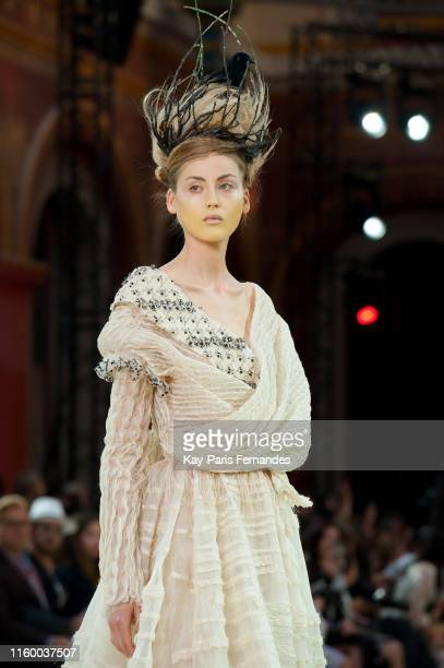 Model walks the runway during the Guo Pei Fall/Winter 2019 2020 show as part of Paris Fashion Week on July 03, 2019 in Paris, France.