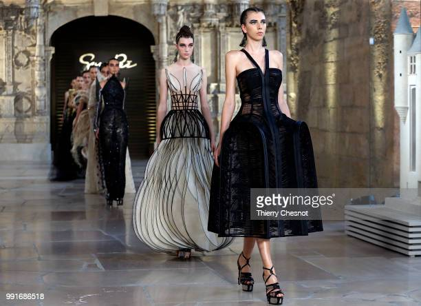 Model walks the runway during the Guo Pei Haute Couture Fall Winter 2018/2019 show as part of Paris Fashion Week on July 4, 2018 in Paris, France.