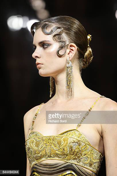 A model walks the runway during the Guo Pei Haute Couture Fall/Winter 20162017 show as part of Paris Fashion Week on July 3 2016 in Paris France