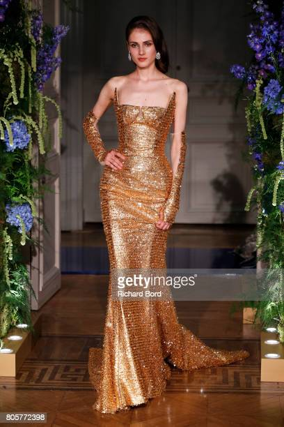 Model walks the runway during the Guo Pei Haute Couture Fall/Winter 2017-2018 show as part of Haute Couture Paris Fashion Week on July 2, 2017 in...