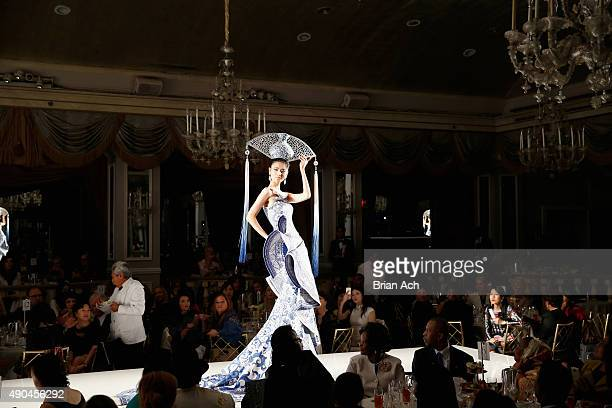 Model walks the runway during the Guo Pei Haute Couture show at the Fashion 4 Development's 5th annual Official First Ladies luncheon at The Pierre...