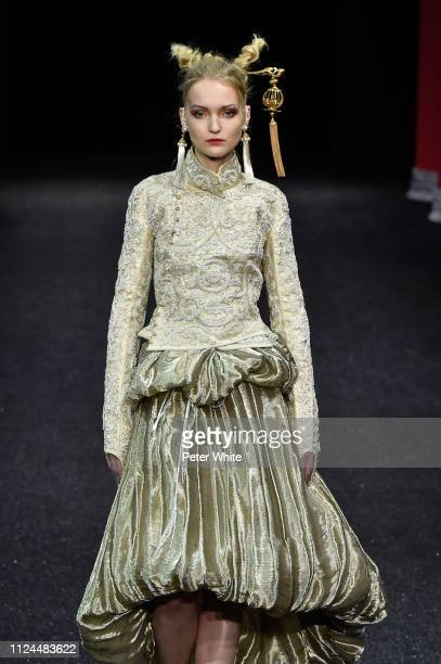 A model walks the runway during the Guo Pei Spring Summer 2019 show as part of Paris Fashion Week on January 23 2019 in Paris France