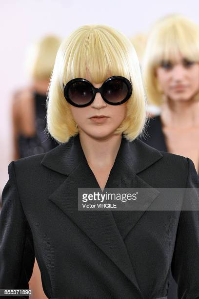 A model walks the runway during the Guy Laroche Ready to Wear Spring/Summer 2018 fashion show tribute to Mireille Darc as part of the Paris Fashion...