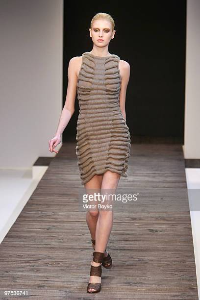A model walks the runway during the Guy Laroche Ready to Wear show as part of the Paris Womenswear Fashion Week Fall/Winter 2011 at Le Carrousel du...