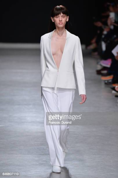 A model walks the runway during the Guy Laroche show as part of the Paris Fashion Week Womenswear Fall/Winter 2017/2018 on March 1 2017 in Paris...